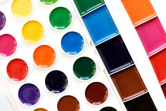 New children& x27;s watercolor colorful paints isolated on white Royalty Free Stock Image