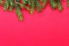 New Christmas background with real pine tree branches. New red Christmas background with real pine tree branches Royalty Free Stock Images