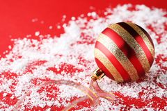 New christmas bauble. With ribbon on white snow Royalty Free Stock Image