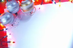 New Christmas baubles border with holiday lights. Stock Photography
