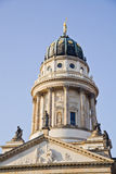 New Church (Deutscher Dom), Berlin. New Church (Deutscher Dom or German Cathedral) on Gendarmenmarkt, with the monument of Friedrich Schiller in the foreground royalty free stock photo
