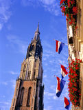 New church and flags at the market place in Delft. Royalty Free Stock Photography
