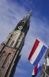 New church and flags at the market place, Delft Stock Image