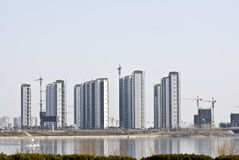 New city of Modern China reflected in the water.  Royalty Free Stock Images