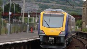 New class 195 Civity dmu train Carnforth. New Northern class 195 Civity diesel multiple unit train leaving Carnforth station, platform 1, on Monday 8th Jult 2019 stock footage