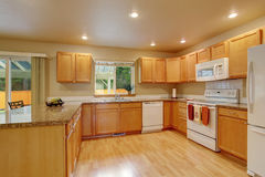 New Classic Wood Large Kitchen With Grey Counter Top. Royalty Free Stock Image