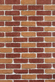 New and clean brown brick wall. Background Royalty Free Stock Photo