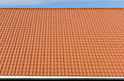 New and clean red tiles roof with rain pipe Royalty Free Stock Photos