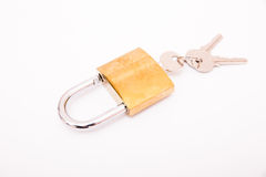 New close metal padlock with keys isolated Royalty Free Stock Photography