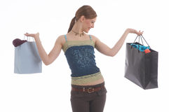 New clothes. A girl with shopping bags Stock Photography