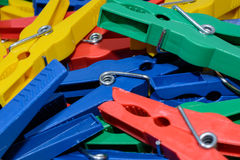New clothes peg. A couple of brand new colored plastik clothes peg stock photo