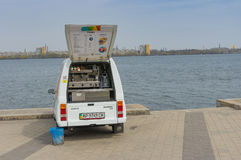 New coffee-car is waiting for the first customer on a Dnepr river embankment. Dnepropetrovsk, Ukraine - April 09, 2016:New coffee-car is waiting for the first stock photo