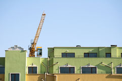 New colored building and crane Stock Images