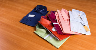 New Colorful Dress Shirts Fanned on Wooden Surface Royalty Free Stock Photos