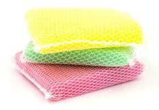New colorful kitchen sponge on white background. Stock Photos