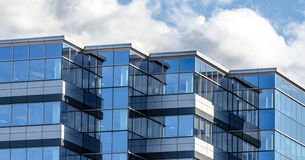 New commercial real estate in the city of Moncton New Brunswick, Canada. Lines and reflections of modern  glass panelled architecture.  New building of office Stock Photos