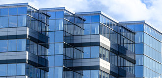 New commercial real estate in the city of Moncton New Brunswick, Canada. Lines and reflections of modern glass panelled architecture. New building of office royalty free stock photo