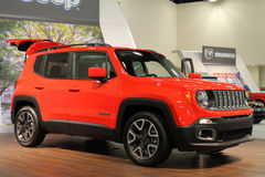 New compact jeep on stand Royalty Free Stock Photography