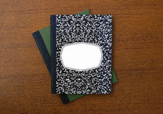 New Composition book and notebook. Composition book and notebook isolated on wood desk background Stock Photos