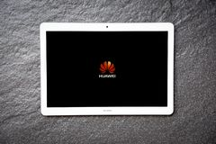 New computer Tablet huawei mediapad t3 10 inch white color with display screen front HUAWEI logo royalty free stock photos