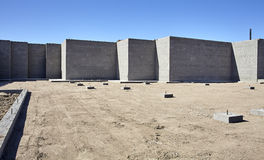 New concrete cement foundation for home building construction in Stock Images