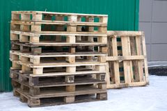 New condition of brown wooden pallets for product distribution and transportation in warehouse Stock Photos