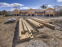 New multi home construction. New condo construction, framed and covered in plywood Stock Photo