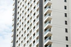New condominium apartment construction exterior pattern. Blue sky royalty free stock image