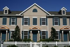 New Condos with Picket Fence. Front view of new condos with white picket Royalty Free Stock Images