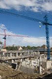 New constraction. Site. Crane, unfinished building, basement royalty free stock photos