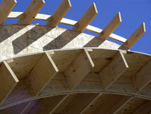 New Construction. Wood framing of new construction against a blue sky Stock Images