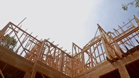 New construction of beam construction house framed the ground up stock video footage