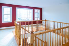 New construction home boasting staircase with wood railings and hardwood floors. New construction home boasting beautiful staircase with wood railings and royalty free stock photos