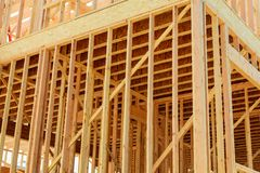 New home construction. build with wooden truss, post and beam framework. New construction home framing New build with wooden truss, post and beam framework Royalty Free Stock Photos