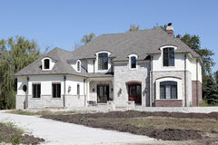New construction home with unfinished landscaping Stock Image