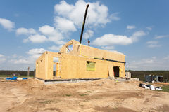 New construction of a house/Framed New Construction of a House/Building a new house from the ground up. Stock Photo