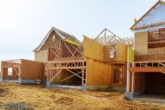 New construction of a house Framed New Construction of a House Building a new house from the ground up. New construction of a house Framed New Construction of a Stock Photos
