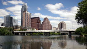 New Construction Office Towers Building Downtown Austin Texas Colorado River. Rolling clouds pass over the Colorado River and downtown Austin stock footage