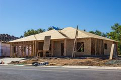New Construction Of Single Family House. Framing & Plywood On New Construction Of Single Family Home stock photos