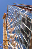 New Construction Skyscraper, Elevators and Reflections Royalty Free Stock Image