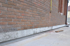 New construction waterproofing basement walls from outside. Stock Photos