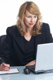 New contact. Businesswoman is writing a new contact to her address book royalty free stock photography