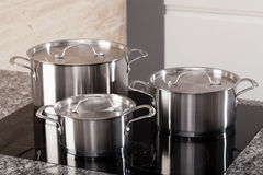 New cookware set on induction hob royalty free stock photos