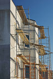 New cottage building. Construction of a two-storey cottage, with scaffolding Royalty Free Stock Photos