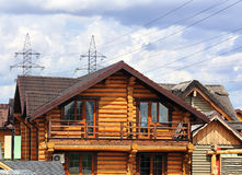 New cottage detail. Wooden cottage of the brown color with balcony Stock Photos