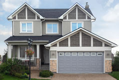 New cottage with garage on first floor. Royalty Free Stock Photo
