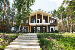 New cottage home in forest. New big cottage home in forest Royalty Free Stock Image