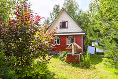 New cottage and well on backyard in village Royalty Free Stock Photo
