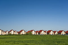 New cottages and blue sky Stock Photography