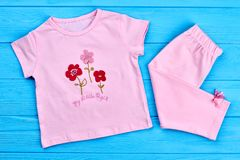 New cotton clothes for toddler girl. Top view of natural summer clothing for little girl. Beautiful cotton summer suit for baby-girl royalty free stock image